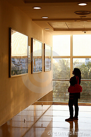 Indian Woman watching Display Posters