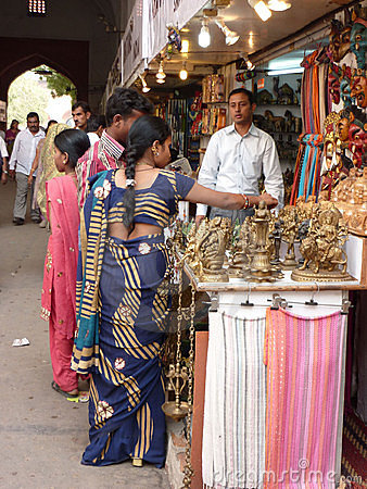 Indian women in colorful saris browse the market Editorial Stock Image