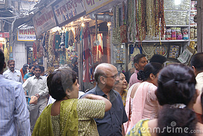 Indian women in colorful saris browse the market Editorial Image