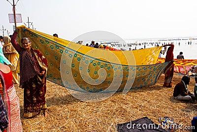 Indian women dry sari on the sun Editorial Photo