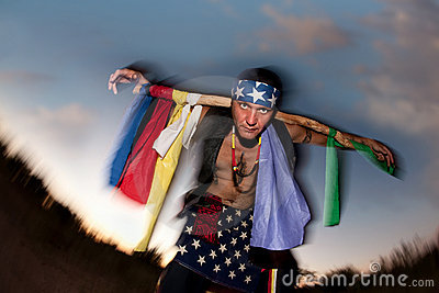 Indigenous man with ceremonial pole