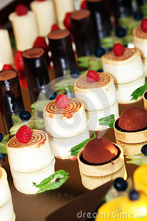 Individual desserts on mirrored surface