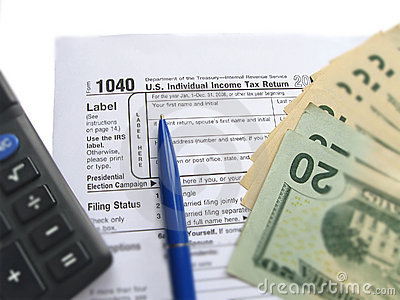 Individual tax return form 1040, calculator, pen Editorial Image