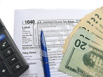 Individual tax return form 1040, calculator, pen Editorial Image