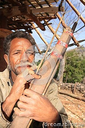 Indonesian hunter with a Coca Cola arrow gun Editorial Stock Photo
