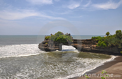 Indonesian temple on sea coast. Tanah lot complex.