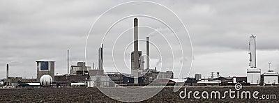 Industrial buildings behind a field