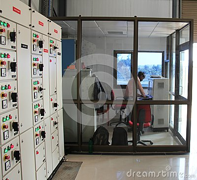 Industrial control room with operator and control  Editorial Photography