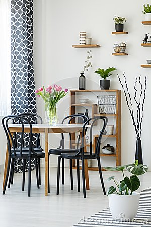 Free Industrial Dining Room Interior With A Table, Black Chairs, Pink Stock Photos - 123140533