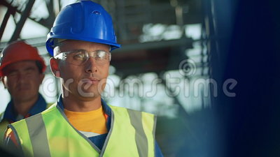 Industrial engineer and worker discussing in factory. Close-up.  stock video