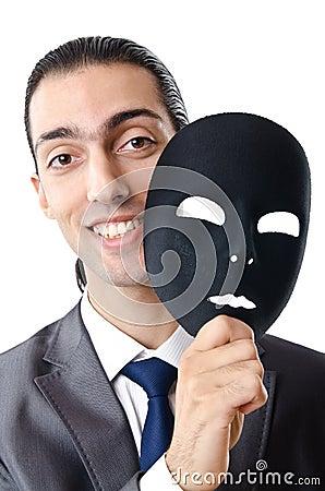 Industrial espionage concept - masked businessman