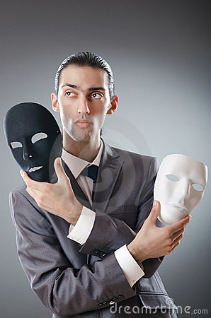 Industrial espionate concept - masked businessman