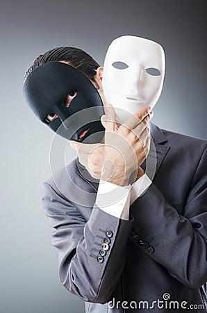 Industrial espionate concept - masked businessman