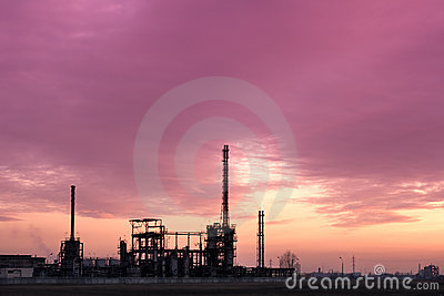 Industrial factory complex at sunset