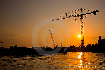 Industrial harbor at sunset and a crane