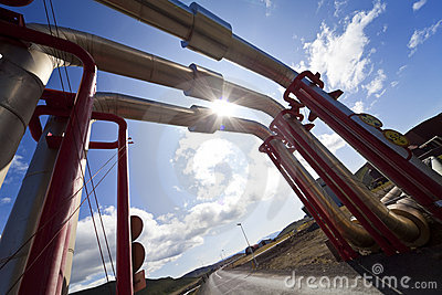 Industrial Pipeline Going Up and Over A Road