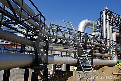 Industrial pipelines against blue sky