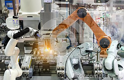 Industrial robot mechanical arm of Electronic Parts Manufacturing Stock Photo