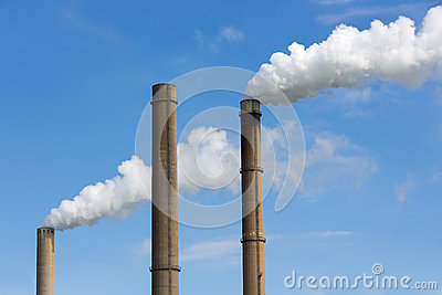 Industrial smoke stacks of a power plant.