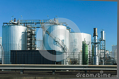 Industrial storage tanks and blue sky