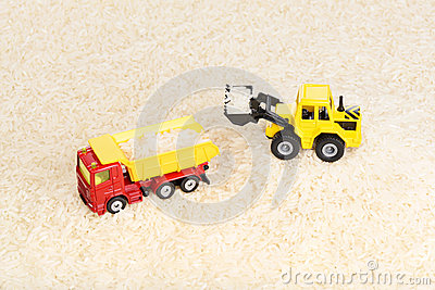 Industrial tractor toy load rice seeds to dump truck