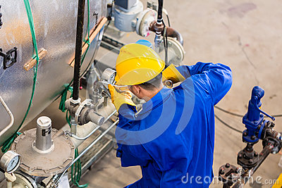Industrial Worker Working At Machine Stock Photo - Image: 59101976