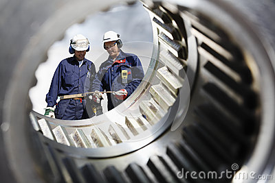 Industry workers and gears shaft