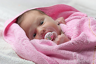 Infant baby in pink towel