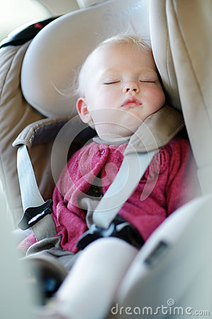 Infant baby sleeping in a car seat