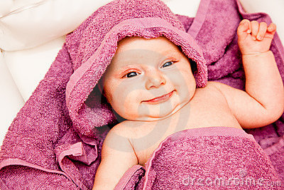 Infant baby in violet towel