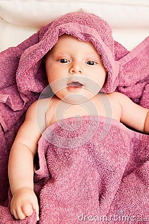 Infant baby in violet towel