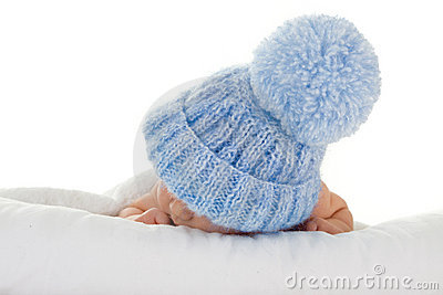 Infant with blue knit hat