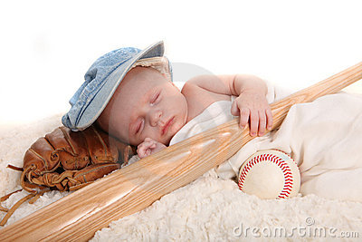Infant Boy Holding Baseball Bat and Sleeping on a