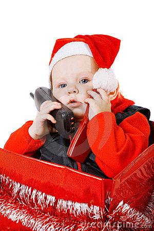 Infant calling by phone in the christmas box