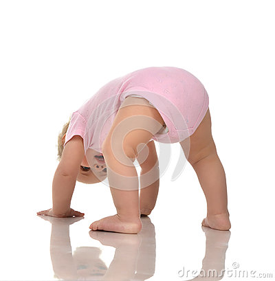 Free Infant Child Baby Girl In Diaper Standing Upside Down On Head In Royalty Free Stock Images - 69177179