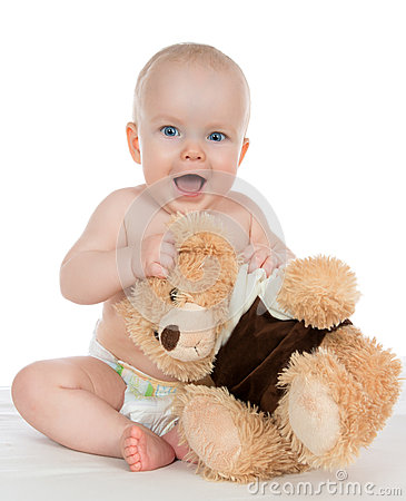Infant child baby girl shouting in diaper with teddy bear
