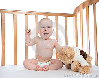 Infant child baby girl toddler shouting in diaper with teddy bea