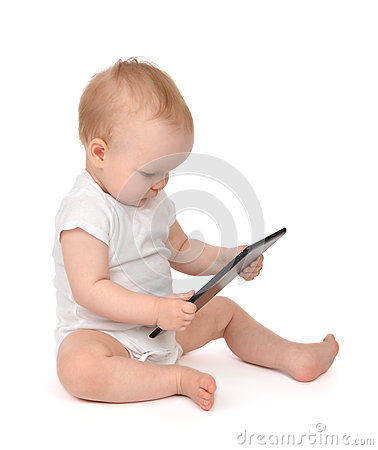Free Infant Child Baby Toddler Sitting And Typing Digital Tablet Mobi Royalty Free Stock Photos - 44941528