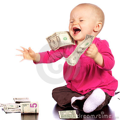 Infant girl waving about her money