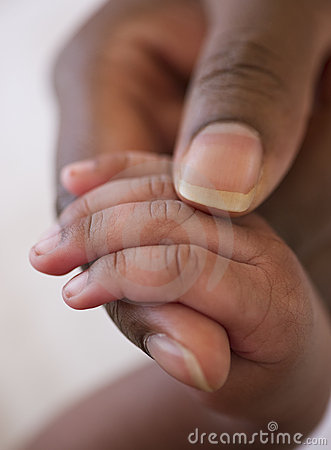 Infant hand in mother s hand