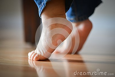 Infant s Precious Feet On Tippy Toes - Innocence Concept