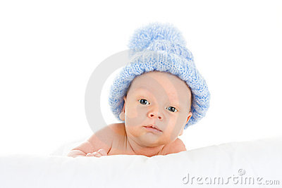 Infant wearing blue knit hat