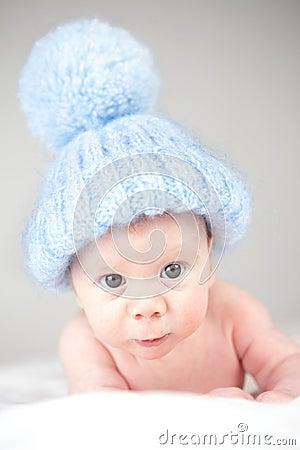 Infant wearing blue knit hat