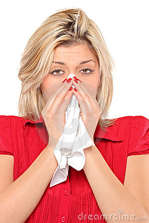 Infected woman blowing his nose in tissue paper