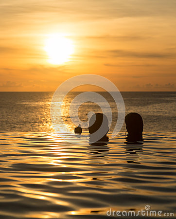 Free Infinity Edge Pool With Sea Underneath Sunset Stock Photos - 29897693