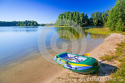 Inflatable dinghy at the summer lake