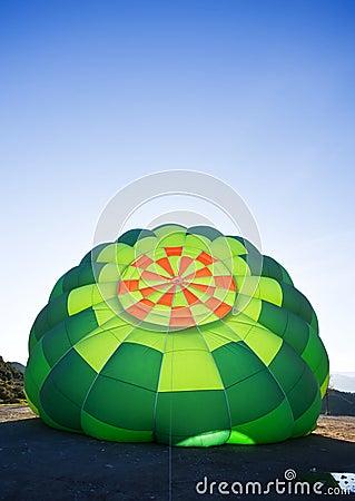 Inflating balloon