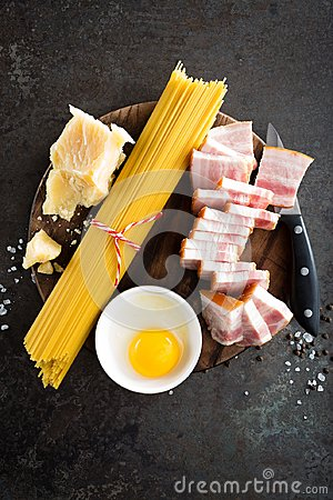 Free Ingredients For Cooking Carbonara Pasta, Spaghetti With Pancetta, Egg And Hard Parmesan Cheese. Traditional Italian Cuisine. Pasta Stock Images - 111813324