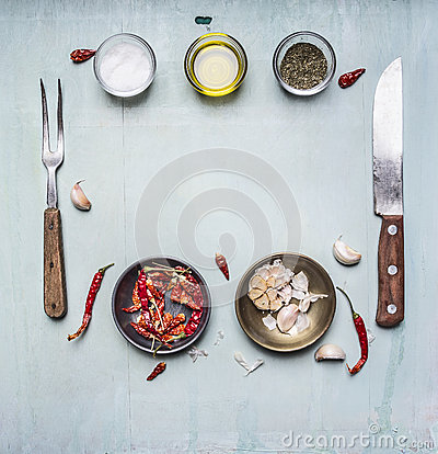 Free Ingredients For Cooking, Seasoning, Oil, Knife, Fork, Garlic, Hot Red Pepper, Lined Frame On Wooden Rustic Background Top View Clo Royalty Free Stock Images - 61713539