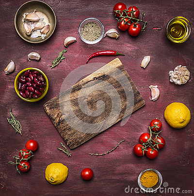 Free Ingredients For Cooking Vegetarian Food Tomatoes On A Branch, Lemon, Olive Oil, Red Hot Pepper, Herbs, Cutting Board , Frame, With Stock Photography - 62501062